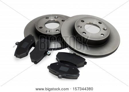four brake pads and two new brake discs for the car