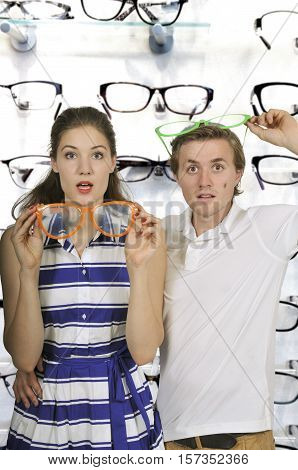 Young couple with silly goofy oversized glasses