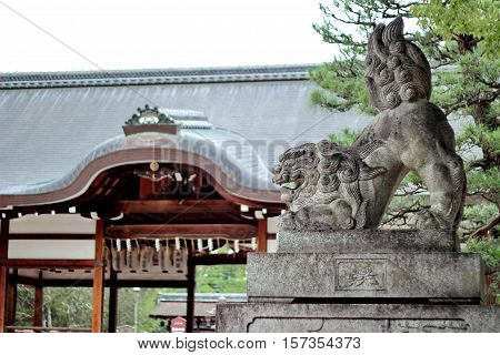 Shisa or Shishi Imperial guardian lions image in JapanThe male lion's jaw image for becky fortune came at Fujinomori shrine KyotoJapan. Selective focus