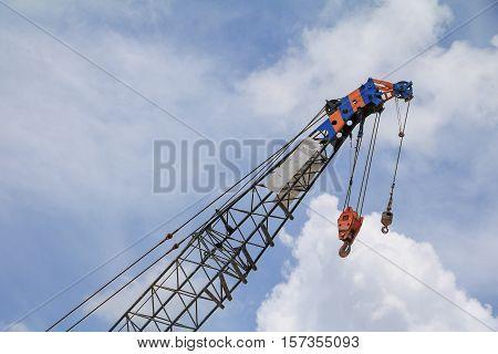 Crane Hook with blue sky background .