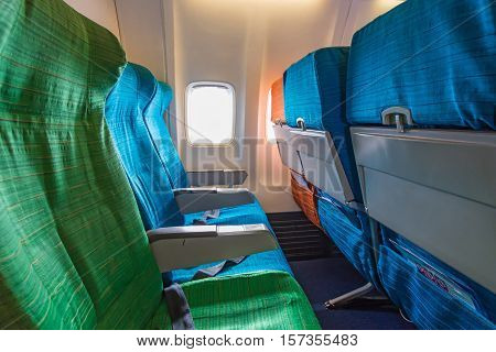 Airplane Seat Near Windows In Cabin Of Huge Aircraft