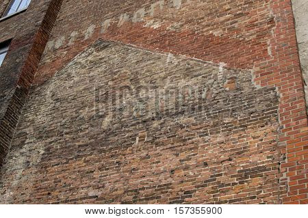 Ancient Brick wall vintage background textured with deteriorating bricks and remnants of old buildings replaced over time background with room for copy