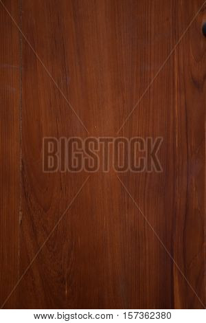 Texture of varnished brown mahogany wood with veins