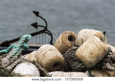 fishing net with floats and anchor lies on the banks during salmon season