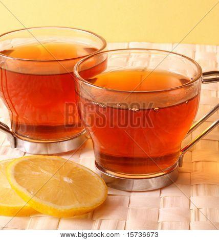 tea time - tea cups with lemon