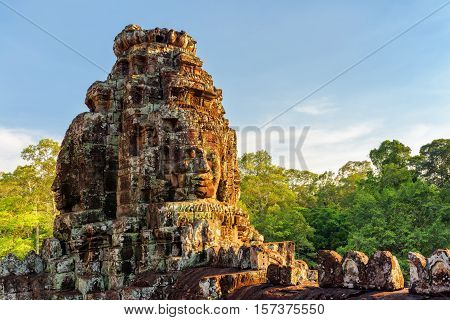 Enigmatic Giant Stone Faces Of Bayon Temple In Evening Sun