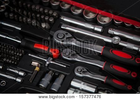 Close up shot of a tool box with various wrenches.