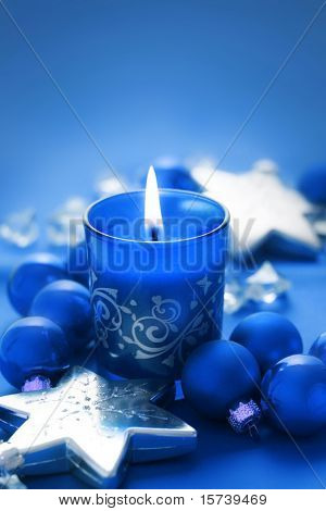Christmas candle on blue background