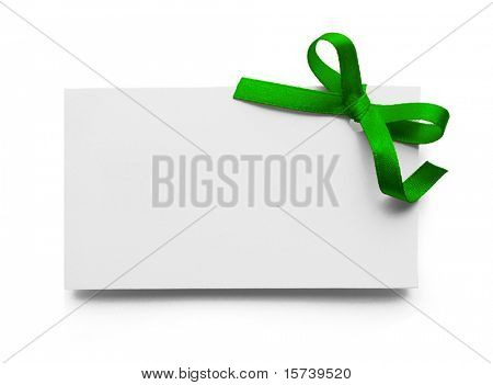 Stock Photo: Blank gift tag tied with a bow of green satin ribbon. Isolated on white, with soft shadow
