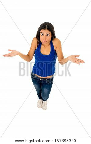 young attractive hispanic woman in casual top and jeans shrinking shoulders open arms wondering confused in doubt isolated on white background