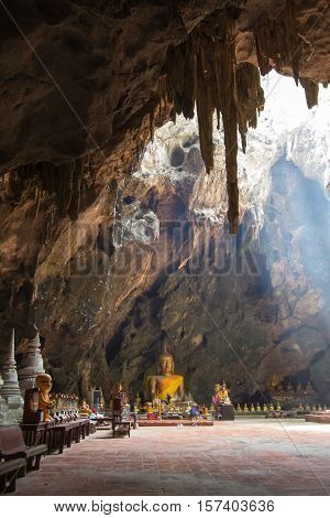 Khao Luang Cave a natural cave with large number of Buddha and large hole on the ceiling allows the rays of light down to the cave floor, located in Phetchaburi, Thailand