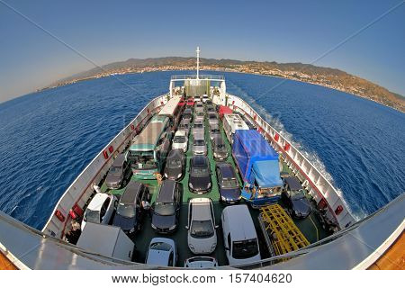 STRAIT OF MESSINA, ITALY - JULY 13, 2016: top view cars ferry boat on Strait of Messina, from the town of Messina to the town of Villa San Giovanni