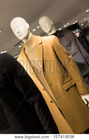men's fashion - mannequins dressed in coats in a clothes store