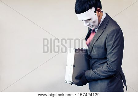 Businessman In Disguise Mask Stealing A Confidential Suitcase - With Copyspace