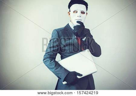 Business Man In White Mask Wearing Gloves And Stealing Computer And Digital Information - Fraud, Hac