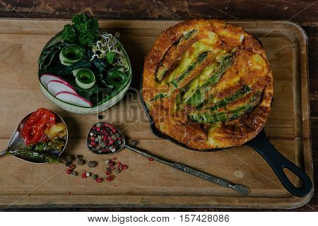 Frittata with asparagus ingridiens onion tomato herbs