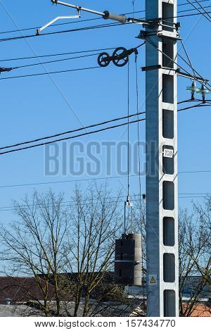 Pillar Of Power Line. Counterweight For Tensioning Wires.