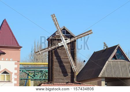 Decorative Wooden Mill. Mill To Decorate The Streets. Houses And Buildings