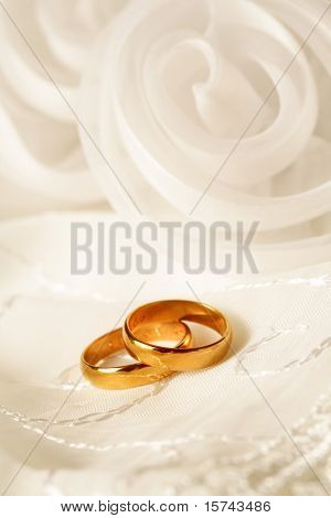 two golden wedding rings, wedding invitation