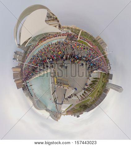 VALENCIA, SPAIN - NOVEMBER 20, 2016: Several runners starting the marathon at start line running Little Planet, November 20, 2016 in Valencia, Spain
