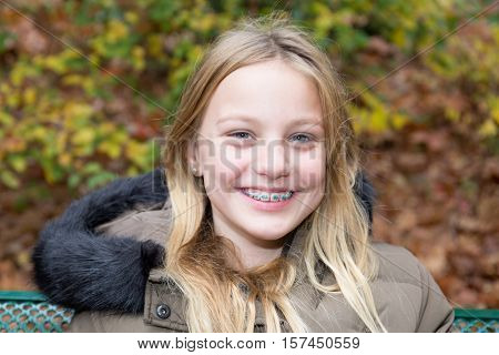 Portrait Of Teenage Girl Smiling Wearing Coat And Scarf