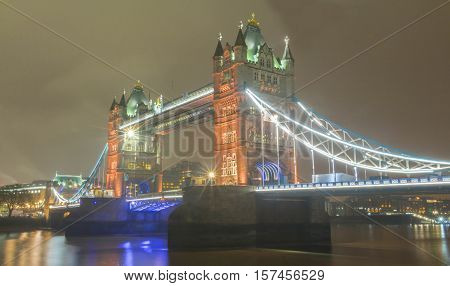 The Tower bridge is a combined bascule and suspension bridge in London built in 1886-1894. It crosses the river Thames close to the tower of London and has become the iconic symbol of London.