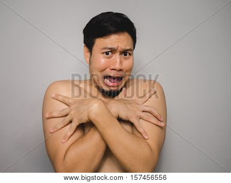 Topless Asian man with funny act of shy and shocked.