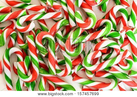 closeup of christmas candy cane making a background