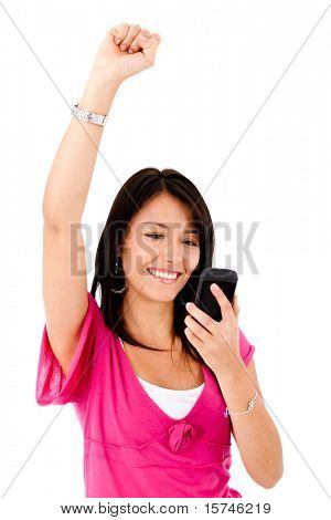 Happy woman reading a text message on her cell phone - isolated over white