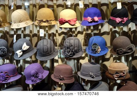 BEIJING - FEBRUARY 22: Hats in the store on the Qianmen street, a famous old shopping street over hundreds years in Beijing, China, February 22, 2016.