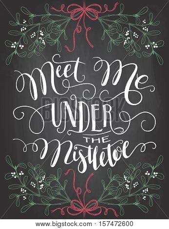 Meet me under the mistletoe. Brush calligraphy on blackboard background with chalk. Christmas chalkboard typography