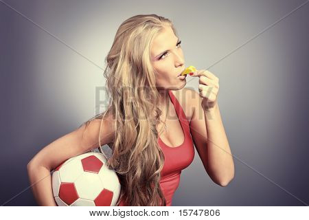 Shot of a sporty young woman with a ball. Active lifestyle, wellness.