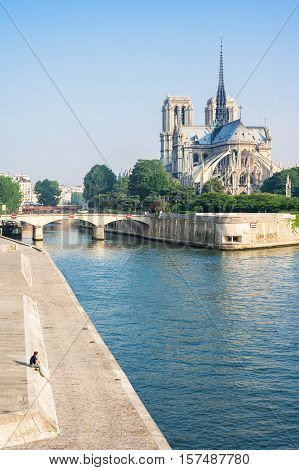 View of Notre-Dame de Paris from the Seine river. Notre-Dame cathedral is a medieval catholic cathedral and finest example of french gothic architecture. Paris France.