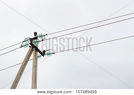 Pillar electricity wire on the background of cloudy sky