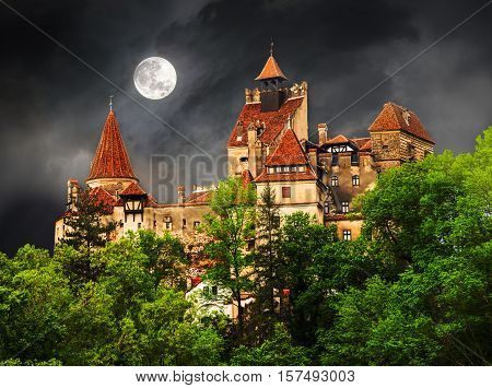 Beautiful and old architecture of the famous Dracula castle in Bran town against the cloudy sky before the storm. Medieval building of Transylvania in Europe Romania