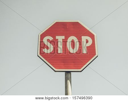 Vintage Looking Stop Sign Over Blue Sky
