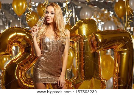 Beauty woman in gold dress