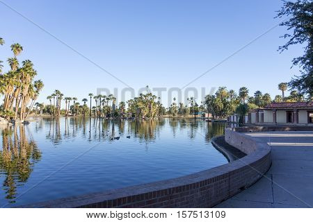Bright blue wintr sky on the lake in Encanto park located right in downtown of Phoenix Arizona; Copyspace