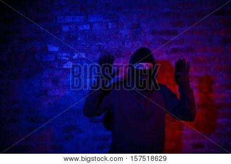 Trapped burglar standing near wall