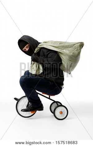 Thief in mask on bicycle