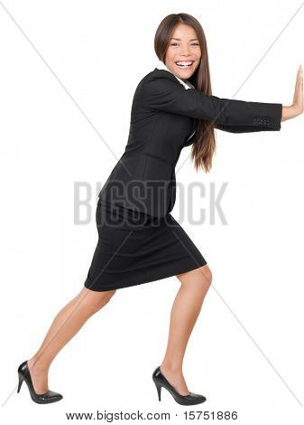 Woman pushing or leaning on wall. Beautiful asian woman smiling isolated on white background in full length.