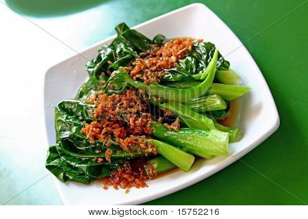 A plate of stir fried chinese vegetables