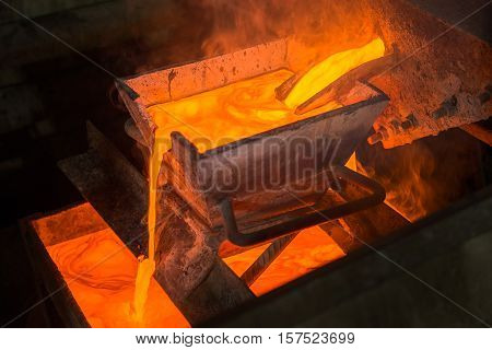 Casting gold at a factory. Gold mining.