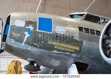 DAYTON, OHIO, USA - NOVEMBER 18, 2016: National Museum USAF is restoring the famous original WWII Memphis Belle B-17F Flying Fortress bomber shown here with infamous girly picture, name & symbols.