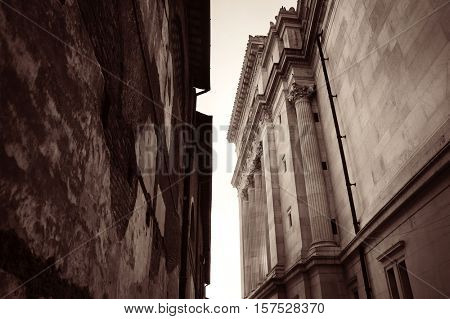 Alley with old buildings and National Monument to Victor Emmanuel II in Rome, Italy.