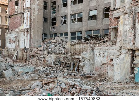 closeup of old building demolition after earthquake