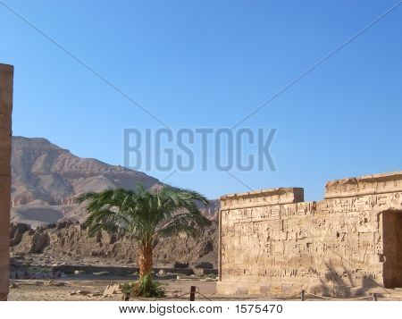 Temple On The King Valley In Medinet Habou With Mountains And A Palm Tree, Louxor, Egypt