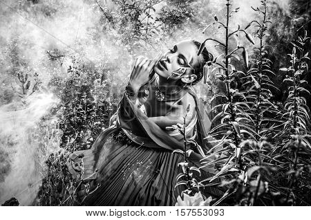 Attractive romantic woman on beautiful dress pose outdoor. Black-white fine art photo.