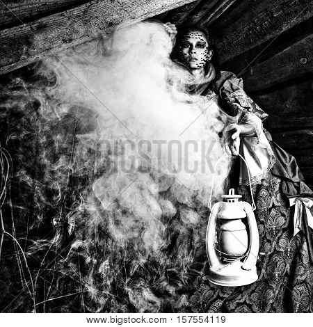 Fine art photo of young woman on ancient dress in a dark mystic wonderland location.