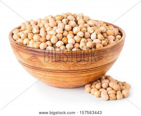 Dry chickpeas in clay bowl with heap of chickpeas near isolated on white background. Uncooked chick-pea. Chickpea grains